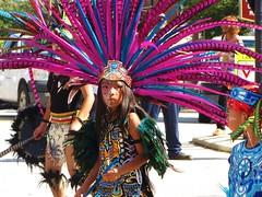 Calm (Gerry Dincher) Tags: internationalfolkfestival parade fayetteville cumberlandcounty northcarolina downtownfayetteville personstreet haystreet marketsquare mexican aztec dancers purple child nino nina feathers headdress