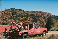 Heavy Duty Towing (Nsharp17) Tags: nikon nikonfe film 35mm kodak ektar ektar100 abandoned vermont foliage autumn fall red orange truck pickup towtruck