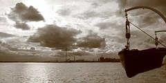 Estuarine Dusk (innpictime ζ♠♠ρﭐḉ†ﭐᶬ₹ Ȝ͏۞°ʖ) Tags: water river dusk sunset sky sunlight cumulus clouds reflection sparkling boat thames kent sbhydrogen essex barge 514513710333409 tender shipsboat lifeboat davits pylon industry dartfordcrossing qeiibridge lightonwater estuary northfleet cumulonimbus