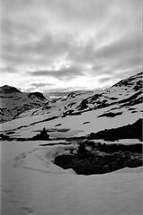 Viltloyfti (IggyRox) Tags: norway norge europe scandinavia north tafjord tafjordfjella reinheim mountains snow hike sky clouds beauty dusk viltloyfti river melting water crossing cairn footprints naushornet skjak oppland film 35mm