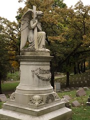 Bluff City Cemetery (Gabrielle Gaia) Tags: bluffcitycemetery elgin illinois il cemetery graveyard grave autumn fall statue statues sculpture sculptures angel angels angelstatue cross crucifix