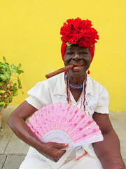 Cuban Woman with Cigar (shaire productions) Tags: cuba cuban image picture travel world culture cultural building caribbean outdoor photo photograph photography portrait woman cigar yellow red bright lady female smile smiling