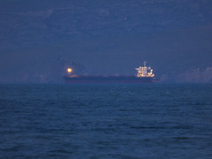 Who Left All the Bloody Lights On (Steve Taylor (Photography)) Tags: freighter lighton blue light lowkey newzealand nz southisland canterbury bankspeninsula christchurch ocean pacific sea waves boat ship cloud night