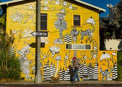 One Way (Margan Zajdowicz) Tags: out door streetphotography streetart venice losangeles mural yellow building oneway streetsign digital zajdowicz availablelight dog man dogwalkingman walkingdog