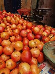 pomegranates in the medina (SM Tham) Tags: africa morocco marrakech medina market pomegranates fruit weighingscales basket newspaper