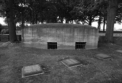 German bunker in Langemarck Cemetary, Belgium (surreyblonde) Tags: 19141918 greatwar ypres somme passchendaele langemark railywaywood battlefield trenches bombardment gas attack war belgium british canadian commonwealth german germany bunker soldiers memorials rememberance ieper iepers flanders bw blackandwhite monochrome poppies remembrance inflandersfields ww1