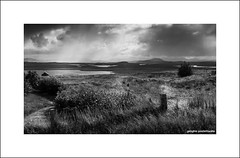 There's rain over Harris (Descended from Ding the Devil) Tags: bw canon40d harris hebrides isleoflewis lochs scotland sigma1020 blackandwhite cloud grass landscape monochrome mountains photoborder rain sky wideangle