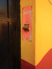 Bright wall with a faded Coca-Cola opener in Talpa, one of Mexico's Pueblos Magicos in the Pacific high sierras (albatz) Tags: sierramadre westcoast buildings talpa mexico pueblosmagicos pacific high sierra wall bright door jalisco town
