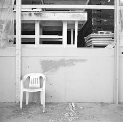 Chair (geowelch) Tags: thejunction toronto urbanfragments commercialbuildings warehouse chair 120 film 6x6 mediumformat kodakt400cn c41 blackandwhite yashicamat epsonperfection4870photo