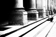 not a smartphone (www.streetphotography-berlin.com) Tags: street streetphotography streetlife woman sitting alone reading uffizi florence tuscany column abstract blackandwhite blackwhite