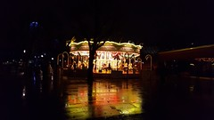 Reflecting upon the carousel in my head - The thoughts are forever revolving yet until the carousel stops... they can't be rid of (AJphotographs1) Tags: views carousel darkness dark light night reflection rain floor colourful photography amateurphotography