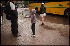 Gipsy kid tries to give a rose to a stranger in the rain. [witch she later will demand cash for] (karlstad Igr) Tags: 28mm wide karlstad wideanglelens m43 mft mirrorless sg fenan microfourthirds wideangleprime panasoniclumixgf1 tingvallagymnasiet panasonicg1425 examen2013