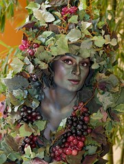 Portrait of a Living World Entertainment's DiVine (Living Vine) (scattered1) Tags: world summer woman plant tree green eye art beautiful face leaves festival fruit pose neck walking nose hotel living leaf costume lasvegas head nevada vine casino lips resort divine nv entertainment strip grapes vegetation venetian performanceart creature performer palazzo graceful carnevale stilt devine lasvegasstrip walkingtree 2013 livingtree livingvine walkingvine livingworldentertainment