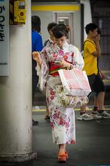 Yukata and Mobile (kasa51) Tags: street people girl station japan lumix platform olympus panasonic yukata f28 kawasaki omd em5 35100mm urbanarte