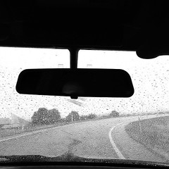 Wet Roads #rain #florida #driving #blackandwhite (ahh.photo) Tags: road blackandwhite bw wet car rain silhouette square mercedes benz drops noir squareformat windshield fogged w124 iphoneography instagramapp