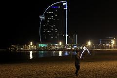 Barcelonetta beach - Barcelona (Une photo mineure) Tags: barcelona show light sea black beach night fire hotel harbour w nightshoot barceloneta garebicing