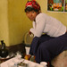 A young woman prepares a traditional Ethiopian coffee ceremony