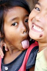 Pull the tongue (Ma Poupoule) Tags: travel portrait people children asia retrato portrt adventure grimace asie enfants enfant ritratti ritratto langue indonsia indonsie mapoule ledeflores
