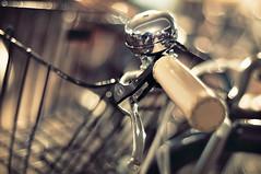 HBW - Bike, Basket, Bell & Bokeh Edition (PhotoJunket) Tags: cambridge reflection bike closeup shiny dof basket bell bokeh handlebar toned hbw leathergripskinky