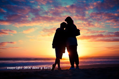 Sunset Silhouettes (Dave G Kelly) Tags: family boy sunset sea sky woman holiday beach portugal beautiful silhouette clouds evening togetherness waves mother son algarve alvor