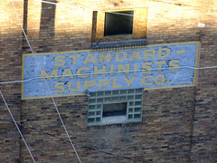 (Shane Henderson) Tags: old blue windows brown sign yellow architecture pittsburgh painted bricks stained faded cables wires worn weathered southside distressed southshore glassblocks ghostsign ghostad standardmachinistssupplyco