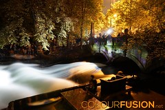 Surfing on the Eisbach (Colourfusion.net) Tags: matthiasgeffert outdoor night long exposure surfing river light effects water wave flow couch eisbach mnchen munich nightofthemuseums nachtdermuseen autumn leaves yellow orange sport sports activites people