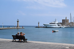 Mandraki Port (lGBSl) Tags: colossus bench port city rhodes sea mandraki statue ocean seven greek pillar couple island deer greece column boat harbour wonders