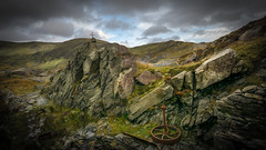 The wheel of Time (Einir Wyn) Tags: landscape isolate industry rocks rugged quarry snowdonia slatequarry outdoor wheel northwales nikon nature natural sky light cloud wales uk