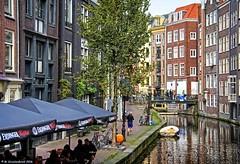 Dutch architecture along the Geldersekade Canal in central Amsterdam (PhotosToArtByMike) Tags: amsterdam geldersekade centrum centercity netherlands dutch holland canalhouse bikes canal bridge