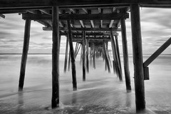 Under the Pier (APGougePhotography) Tags: obx outerbanks north carolina northcarolina longexposure le lightroom blackandwhite bw nikon avalon pier water beach sea seascape nikond800 silverefexpro nik nikcollection