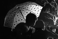 Say Kimchi (Elios.k) Tags: horizontal outdoors people two couple man woman together selfie photo smartphone umbrella rain rainy weather peacesign posing cheonjiyeonpokpo cheonjiyeon waterfall falls night dark light bw blackandwhite monochrome travel travelling summer august 2016 canon 5dmkii camera photography seogwipo jeju jejudo island korea southkorea asia