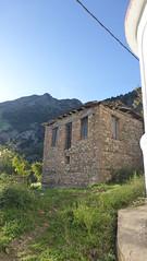 P1270351 (omirou56) Tags: 169 panasoniclumixdmctz40              kalavrita digela sky windows village greece hellas wall roof mountain