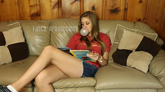 Jenny Blowing Bubbles while Reading a Magazine (Fanta_Productions) Tags: bubblegum bubblegumfetish blowingbubbles girlsblowingbubbles shortshorts longlegs femalelegs