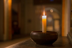 Candle in a church (PhotoChampions) Tags: candle candlelight kerze kerzenlicht kirche bokeh