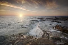 Burghead (Michael Carver Photography) Tags: sunset sea sky seascape wet clouds landscape photography scotland highlands nikon rocks waves scottish wellies burghead sigma1020mm d7000