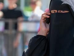 "Bagdad Cafe: ""I am calling you, Can't you hear me"" (ybiberman) Tags: portrait woman israel eyes candid muslim jerusalem hijab streetphotography cellphone niqab ramadan oldcity alquds damascusgate haramalsharif fridayprayer"
