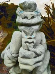 Choked (Steve Taylor (Photography)) Tags: park newzealand christchurch sculpture statue tongue stone club nose eyes south shell canterbury carving strangle fist nz southisland glowing maori choke paua newbrighton southbrighton cudgle