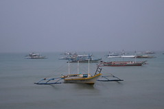 Bacuit bay (Ivanasahara) Tags: ocean blue sea storm water beautiful clouds asian boats grey bay boat mar fantastic asia paradise barco barcos philippines tropical southeast oceano palawan bangka tropico ocen bangkas