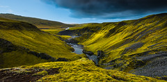 Dressed in green (Explored) (Tore Thiis Fjeld) Tags: light shadow sky sunlight green nature clouds contrast river iceland nikon canyon september getty rugged d800 slopes lakaggar fagrifoss explored