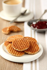 Mini stroopwafels (syrupwaffles) on a plate with cup of coffee and jam (Iryna Melnyk) Tags: food brown white holland cup broken netherlands coffee dutch breakfast circle crust dessert cuisine golden healthy cookie candy drink sweet eating object group plate fork nobody spoon gourmet delicious whole crisp biscuit caramel pile bakery snack meal round pastry espresso syrup treat thin typical jam heap wafer treacle waffle indulgence baked stroopwafel