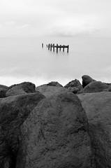Sea Defence (Aaron James Rodgers) Tags: longexposure sea bw beach nikon rocks groyne d7000 triggertrap hoyandx32