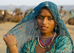 Rekha (Blinkofanaye) Tags: india girl face animal festival tattoo eyes indian traditional fair pushkar rajasthan ajmer 2013