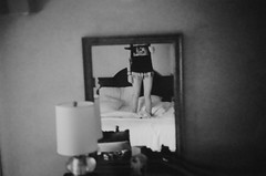 (taylor anne medwid) Tags: shadow vacation portrait blackandwhite woman black reflection film lamp girl self 35mm canon grey hotel mirror bed shadows legs body room gray 35mmfilm shade grayscale 35 hotelroom greyscale blackandwhitephotography selfie miroor
