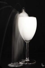 Chûte de lait (loralepoder) Tags: water milk waterdrop eau lait verre milkdrop fondnoir floudebougé chûte verreàpied gouttedelait éclaboussurelait photosurfondnoir
