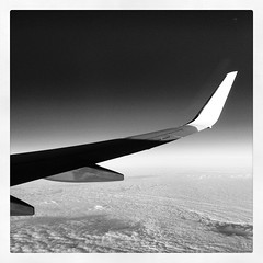 5 Jan 2014 (Rob Rocke) Tags: travel windows sky blackandwhite bw monochrome clouds skies escape altitude airplanes flight aerialviews rr transportation americanairlines vacations portals getaways airplanewings instagram