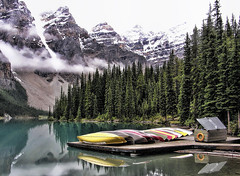 Glaciers' Gift (Wes Iversen) Tags: trees canada mountains nature clouds reflections lakes canoes alberta banffnationalpark morainelake canadianrockies hcs clichsaturday