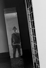 lost in the echo (Super G) Tags: sanfrancisco california blackandwhite bw selfportrait reflection hat bars hunterspoint scs dirtymirror selfcenteredsunday nikon218 abandonedandreclaimed dirtymirroredition