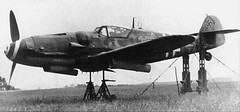 A Messerschmitt Bf 109G-6 of 12./JG 2 is prepared for test firing 21cm rockets at Beaumont Le Roger in 1943