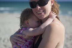 Laura and Emily cuddle 2 (dan.oxlade) Tags: d40 mother child toddler beach sea sunglasses polarisingfilter polarising nikon nikkor nikkor50mm118g