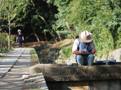 Painter at Philosopher's Walk in Kyoto, Japan (Tamas V) Tags: outdoor painter painting artist kyoto japan art creative creating asia japanese bokeh bokehful bokehlicious olympus travel traveling travelling traveler philosopher philosophers walk philosopherswalk historic canal path shallow dof depthoffield shallowdepthoffieldshallow 75mm olympus75mm wideopen f18 18 75mmf18 nature peaceful calm omd em5 omdem5 microfourthirds fourthirds mft m43 43 u43 micro four thirds explore exploring street istock getty images gettyimages stockphotograph stockphotography stockphoto photo photograph photography photojournalism documentary life travelphoto travelphotograph travelphotography editorial active prime telephoto fastprime